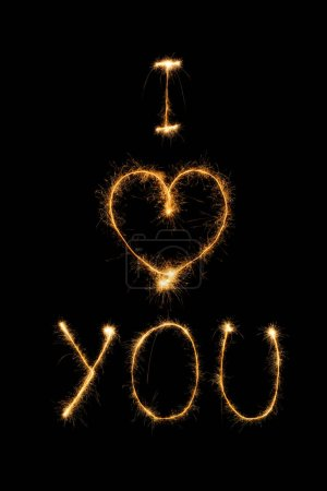 close up view of i love you light sign on black background