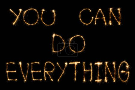 close up view of you can do everything light lettering on black backdrop