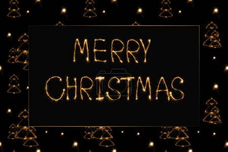 close up view of merry christmas light lettering and fir tree light signs on black background