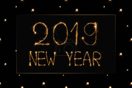Photo for Close up view of 2019 new year light sign on black background - Royalty Free Image