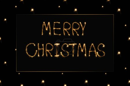 close up view of merry christmas light lettering on black backdrop