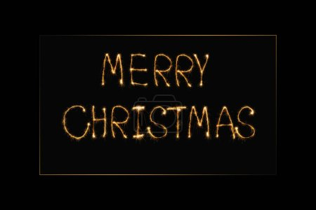 Photo for Close up view of merry christmas light lettering on black backdrop - Royalty Free Image