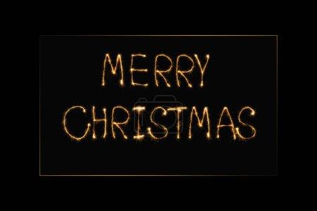 Photo pour Vue rapprochée de joyeux Noël lettrage de lumière sur fond noir - image libre de droit
