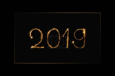 close up view of 2019 year light sign on black background