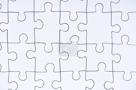 Photo for Full frame of white puzzle pieces background - Royalty Free Image
