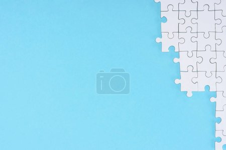 Photo for Flat lay with white puzzle pieces on blue background - Royalty Free Image