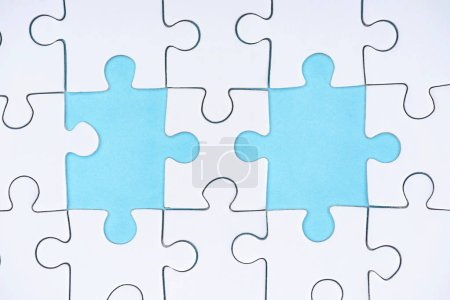 flat lay with white puzzle pieces on blue background