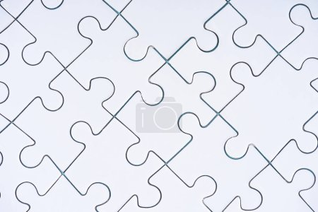 full frame of arranged white puzzles background