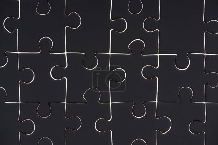 full frame of black puzzle pieces background