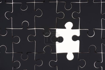 full frame of black and white puzzle pieces background