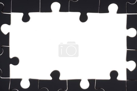 Photo for Full frame of black and white puzzles backdrop - Royalty Free Image