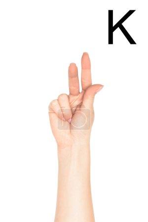 Photo pour Vue partielle de femme montrant latine lettre - K, sourd et muet langage, isolé sur blanc - image libre de droit