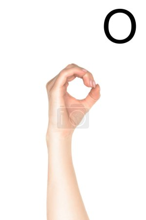 partial view of woman showing latin letter - O, deaf and dumb language, isolated on white