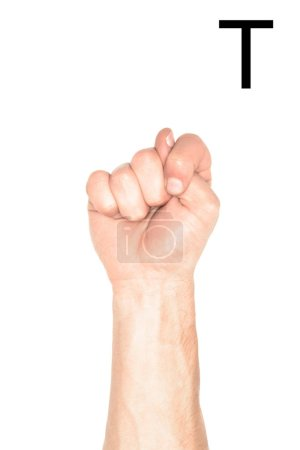 partial view of male hand showing latin letter - T, deaf and dumb language, isolated on white