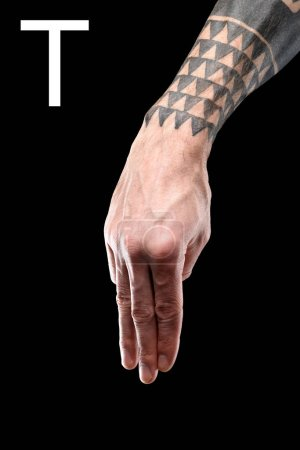 tattooed hand showing cyrillic letter, deaf and dumb language, isolated on black