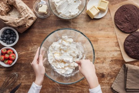 Photo for Partial top view of woman preparing dough for delicious homemade cake - Royalty Free Image