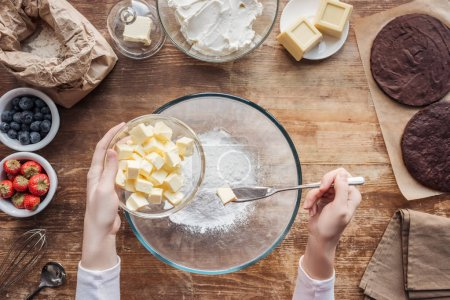 Photo for Partial top view of woman mixing ingredients and preparing dough for homemade cake - Royalty Free Image