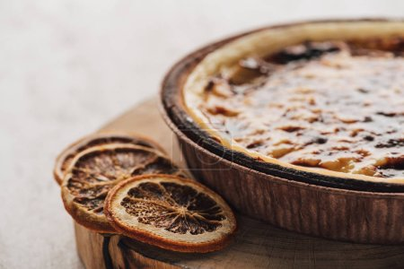 Photo for Delicious flan cake with caramel and citrus slices on wooden board - Royalty Free Image