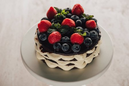 Photo for High angle view of gourmet homemade whoopie pie cake with fresh blueberries and strawberries - Royalty Free Image