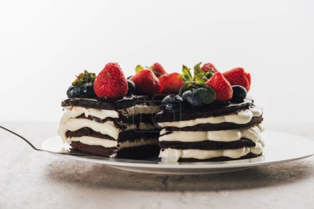 Photo for Pieces of gourmet whoopie pie cake with fresh berries on white plate - Royalty Free Image