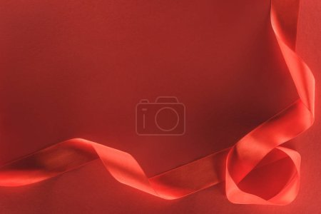 view from above of red festive ribbon isolated on red, st valentine day concept