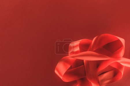 Photo for Elevated view of red festive ribbon isolated on red, st valentine day concept - Royalty Free Image
