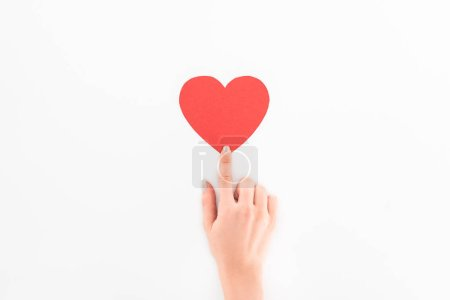 cropped shot of woman pointing at red heart symbol isolated on white, st valentine day concept