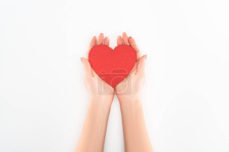 partial view of woman holding red heart symbol isolated on white, st valentine day concept