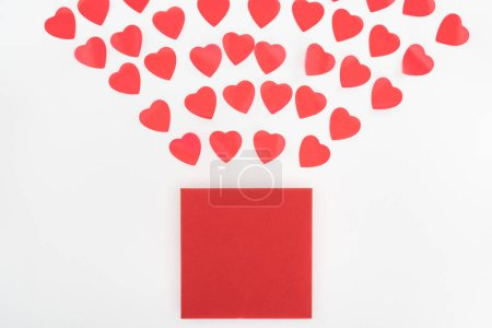 flat lay with heart symbols and envelope isolated on white, st valentine day concept