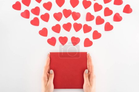 Photo for Cropped shot of woman holding envelop under dozen red heart symbols isolated on white, st valentine day concept - Royalty Free Image