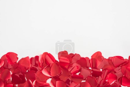 close-up view of beautiful red heart shaped petals on grey background, valentines day concept