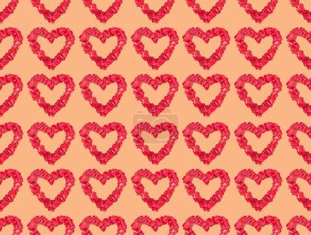 Foto de Patrón sin fisuras de hermosos decorativos corazones rojos sobre fondo naranja - Imagen libre de derechos