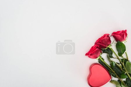 beautiful decorative red heart and tender rose flowers isolated on grey background, valentines day concept