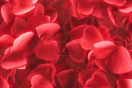 close-up view of decorative red heart shaped petals, valentines day background