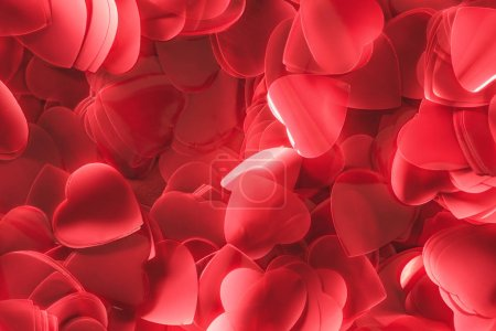 close-up view of beautiful decorative red heart shaped petals, valentines day background