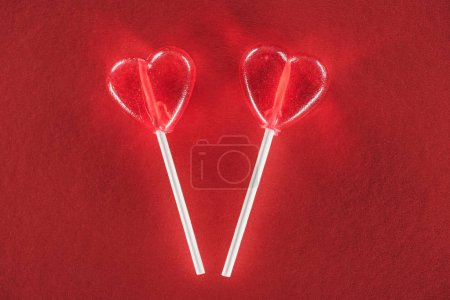 close-up view of heart shaped lollipops on red background, valentines day concept