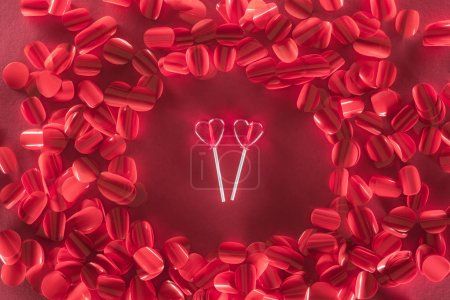 Photo for Two heart shaped candies and beautiful red petals, valentines day concept - Royalty Free Image