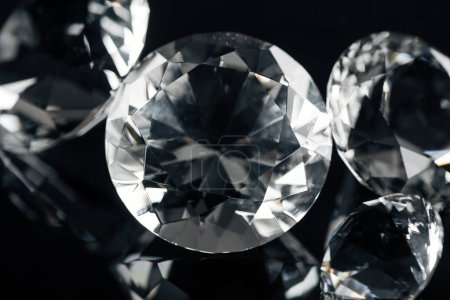 collection of pure shiny diamonds isolated on black
