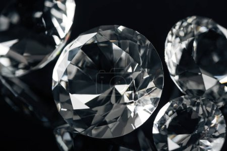 collection of clear diamonds isolated on black
