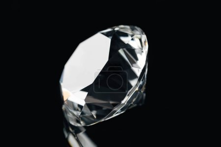 pure shiny diamond isolated on black