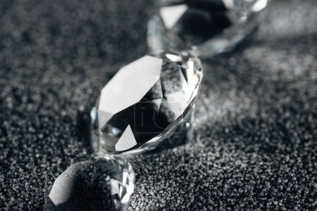 Photo for Close up of pure diamonds on grey textured background - Royalty Free Image