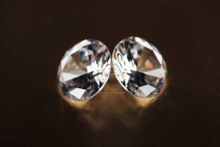 close up of big pure diamonds on golden dark background