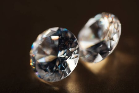 Photo for Close up of big transparent diamonds on golden dark background - Royalty Free Image
