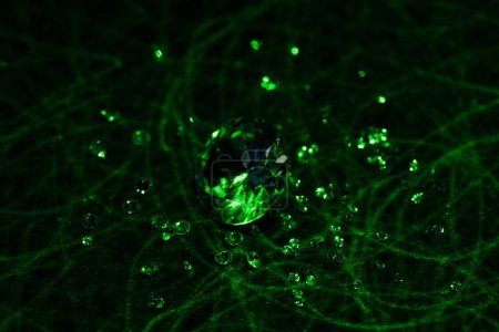 big and small diamonds with bright green neon light on dark background