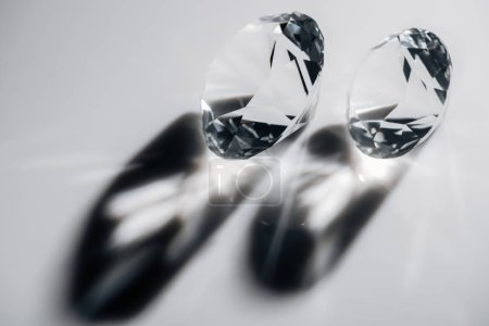 shiny clear diamonds with shadows on grey background