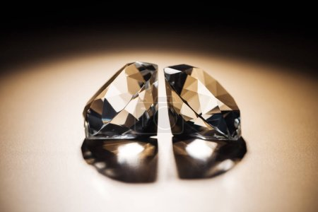 two clear big diamonds on black and golden background