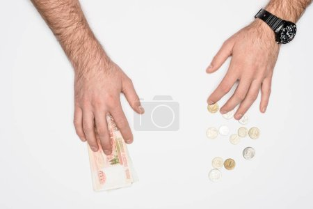 partial view of male hands with Russian rubles and coins isolated on grey