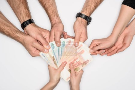 cropped view of group sharing Russian banknotes isolated on grey