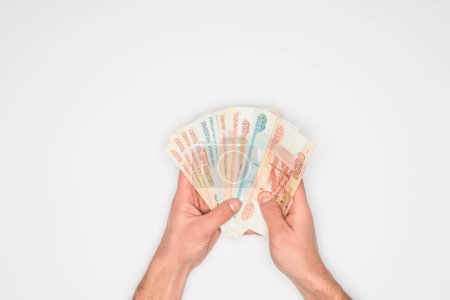 cropped view of man holding russian banknotes in hands isolated on grey