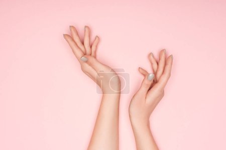 Photo for Cropped view of female hands isolated on pink - Royalty Free Image
